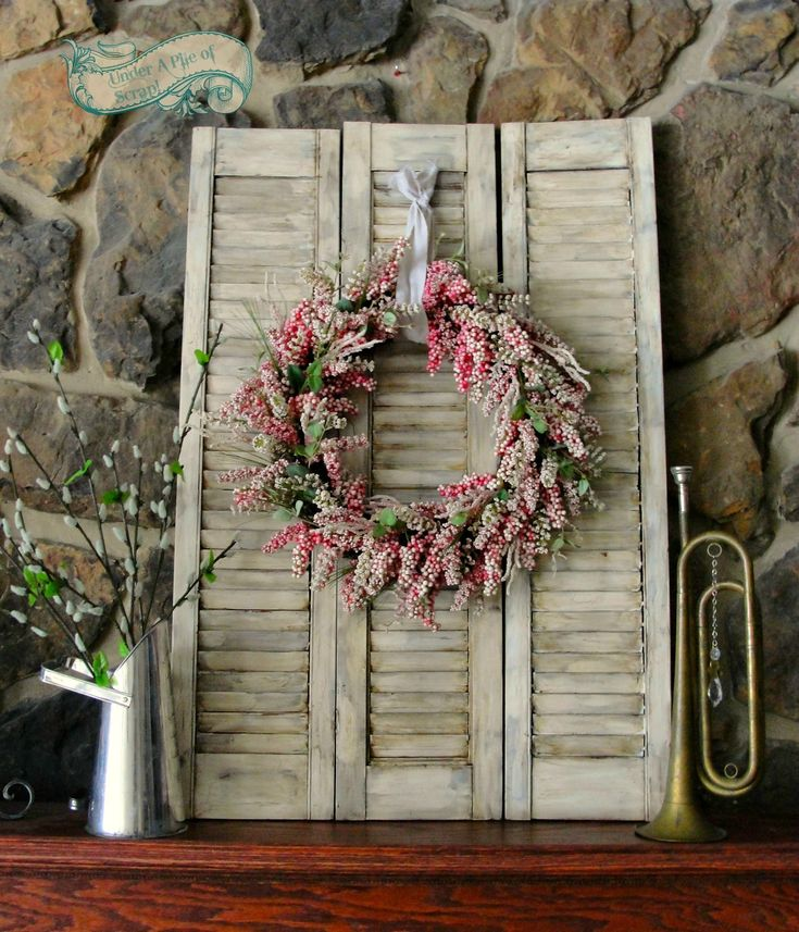 Primitive distressed shutters with spring wreath