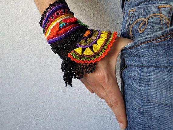 freeform crochet cuff - Gloriosa Superba: bracelet with colorful beaded crochet flowers and black crochet lace