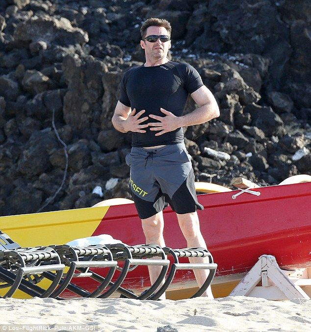 Dressed: Hugh arrived at the beach in a tight-fitting T-shirt and sunglasses