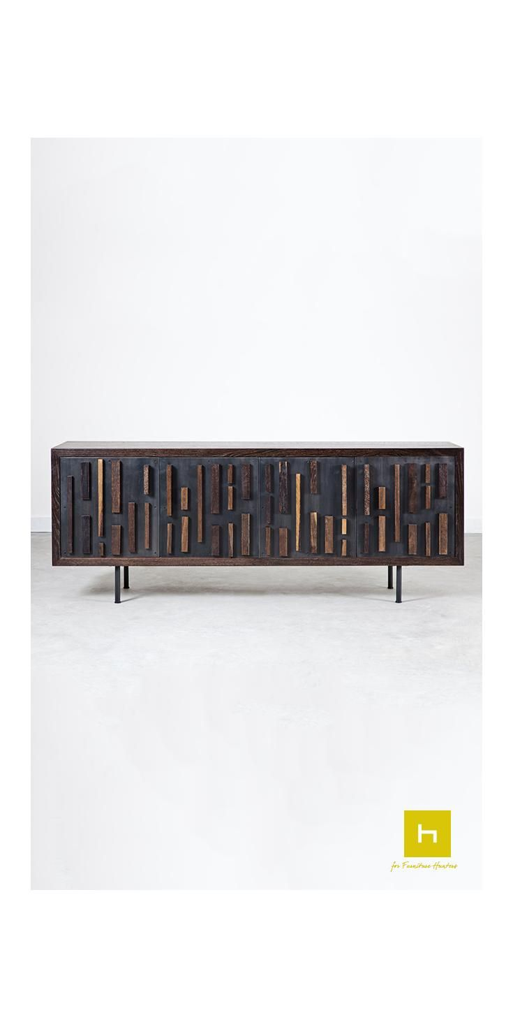 The Blok Sideboard in Black seared oak is designed by Square Roots.  The solid panels of the sideboard doors are accented with blocks of oak, to create an interesting mix of shapes and materials.  #furniture #interiordesign #furnituredesign #designerfurniture