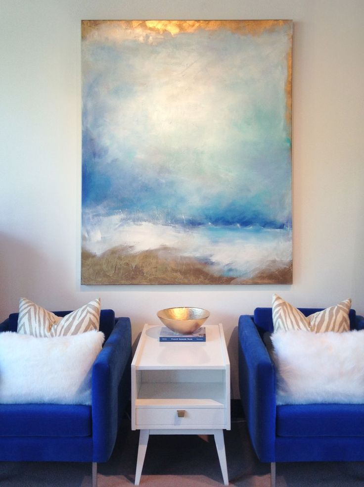 "Original Painting ""Oceania"" by Julia Contacessi on display with navy, gold and white accents"