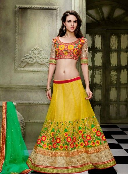 Yellow embroidered wedding wear lehenga choli in net J15585