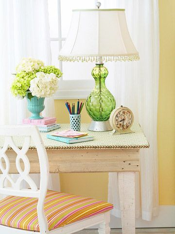 This vintage table doubles as a desk and a bedside stand. To soften the look for the bedroom, cover the top with fabric and fasten it along the edges with upholstery tacks.