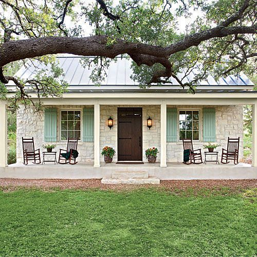 This casual Hill Country cottage pours on the Southern charm with its familiar farmhouse form, picture-perfect proportions, and inviting front porch nestled beneath a curtain of large oak trees. The stone facade and metal roofing nod back to Fredericksburg's original German-style architecture. We'd love to kick up our feet and wind down our week in this soulful country home.: