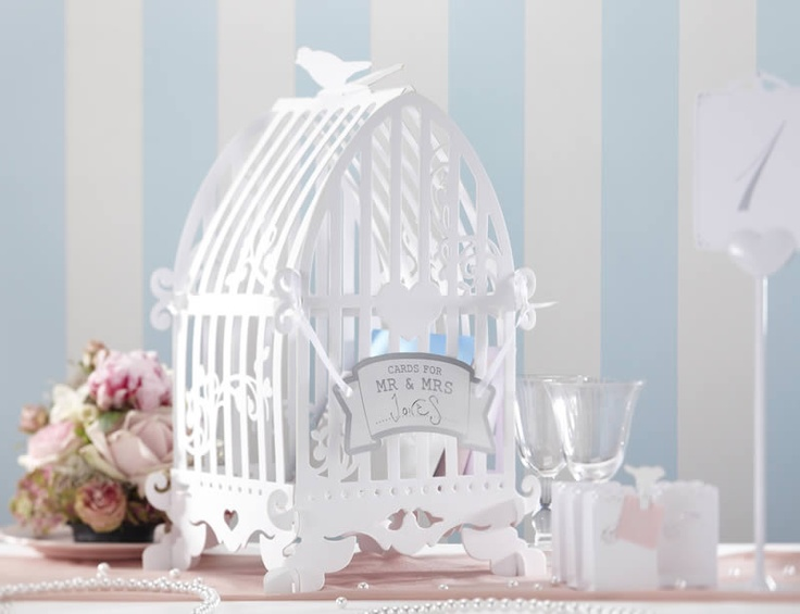 This enchanting white Birdcage Card Holder, made of heavy duty card, makes   an ideal post box for collecting your guests cards. Alternatively, fill it with flowers or adorn it in pearl strings to make a stunning centerpiece   or display.     The birdcage comes flat packed and is simple to put together. Dimensions: 50cm   x 22cm x22cm