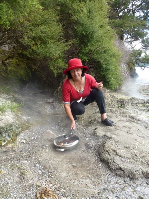 Karen Walmsley does not need a stove to cook lunch, all she needs is the hot sand at Te Rata Bay, Lake Tarawera. Photo taken by David Walmsley.