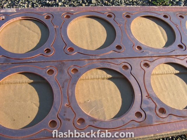 Copper head gaskets water jet cut.