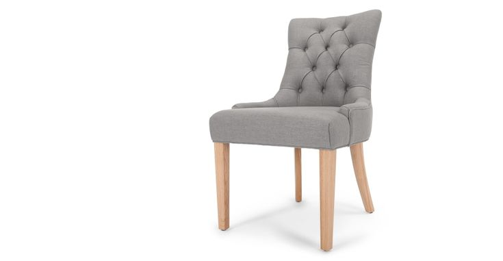 The Flynn scoop back chair in graphite grey adds an elegant twist to any dining room, living room or bedroom.