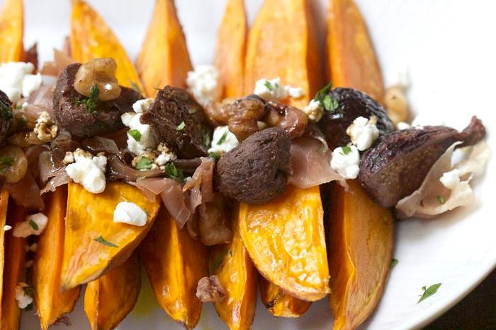 """Roasted Sweet Potatoes with Dried Figs"" -- Add in some ""jamón serrano, a variety of cured Spanish ham,"" (my favorite!) and I'm in!"