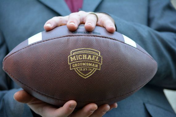 Really fun fall themed groomsmen gift:  personalized footballs! http://emmalinebride.com/groom/unique-groomsmen-gifts-2015/