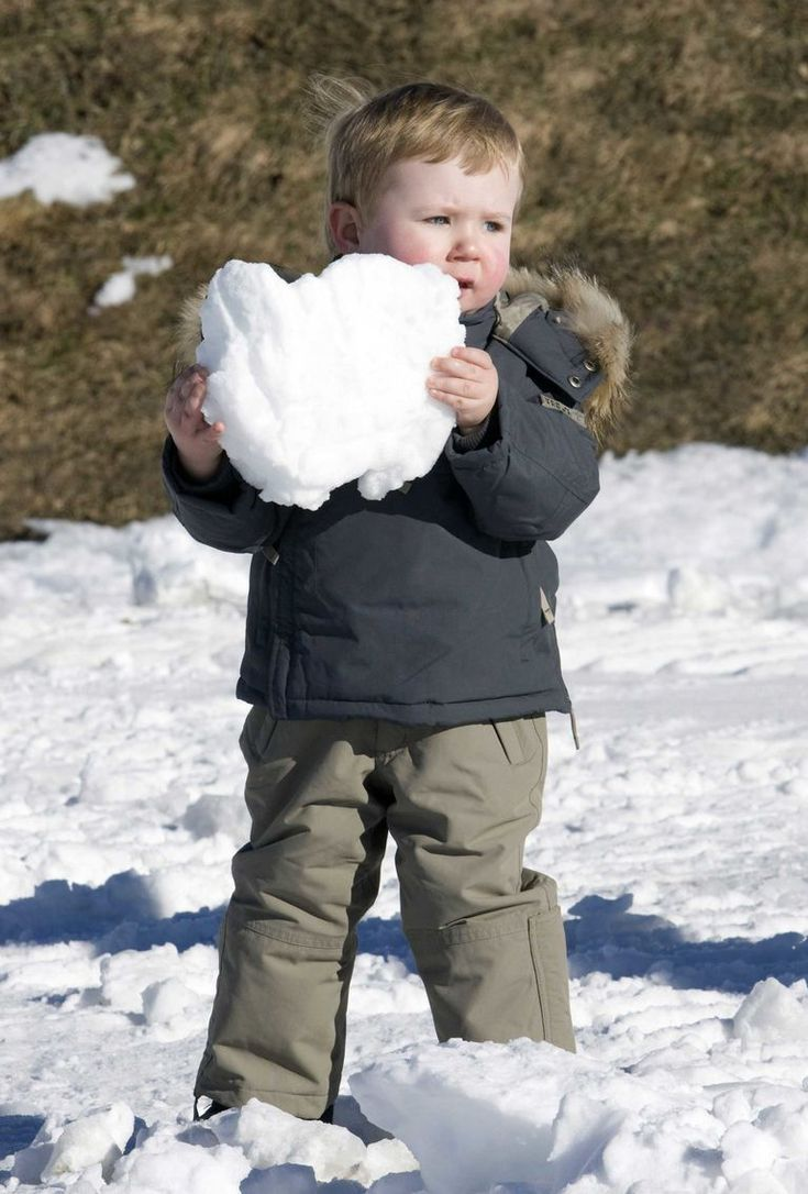 Prince Christian of Denmark plays adorably in the snow.