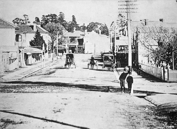 Ivanhoe shopping centre (1900): Photo taken from junction of Upper Heidelberg Road and Waterdale Road. Ivanhoe Fire Station in centre, Ivanhoe Hotel (since demolished) on left. Henry Knorr's grocery on right. Dr. Latham's medical rooms have customary lamp over entrance gate, extreme right.