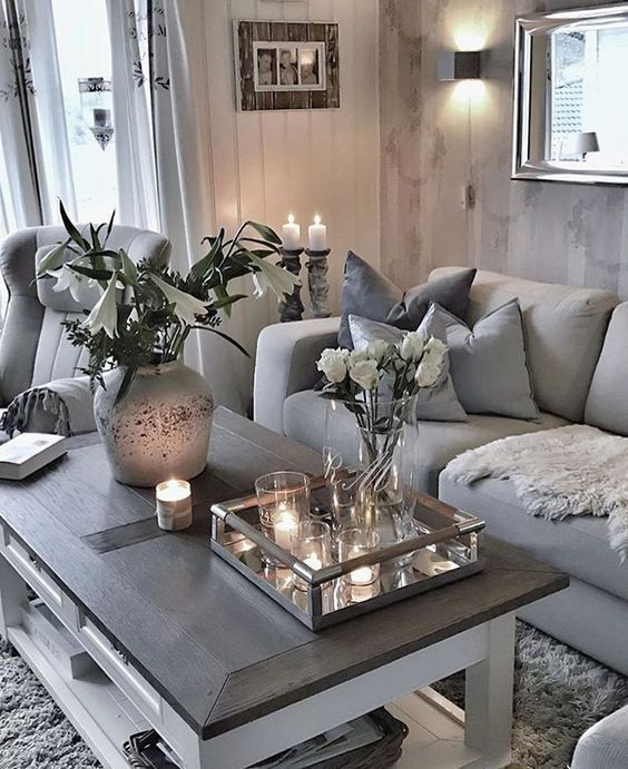 Love this cozy living room space  Wood coffee table  mirrored tray with  candles  flower arrangements  grey and beige couch and chair with cozy  pillows and. 29 best living Room ideas images on Pinterest