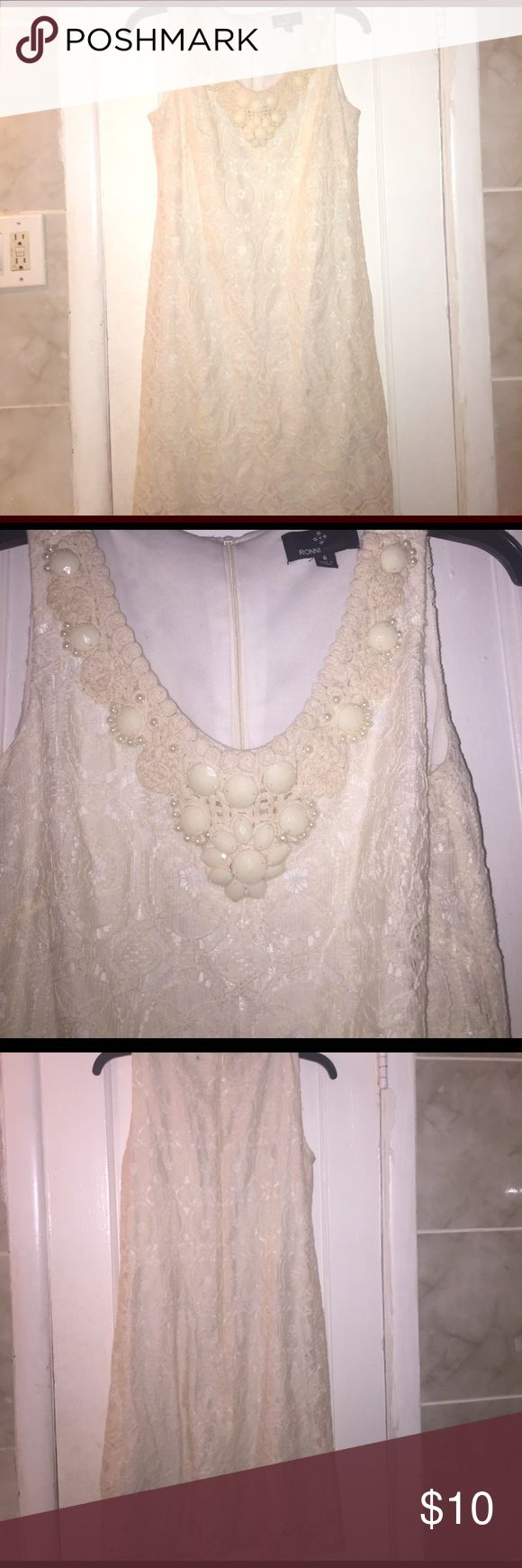 Amazing dress 👗 A fabulous cream colored Ronni Nicole dress perfect for a night out on the town❗️ A laced V-Neck mini dress. This was never worn. Dresses Mini
