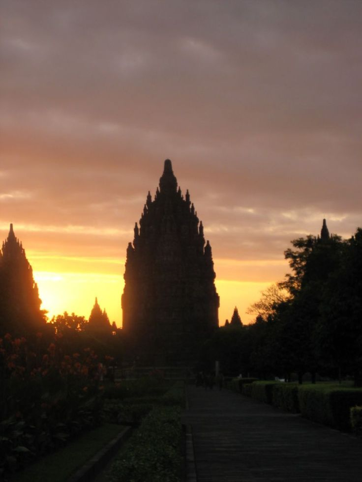 sun setting over a temple in Indonesia