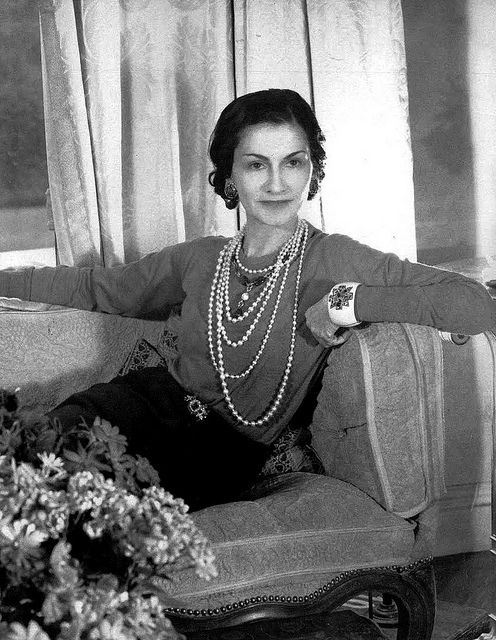 Coco Chanel -she was raised in an orphanages and taught to sew.  She was known for her simple yet sophisticated outfits paired with great accessories, such as several strands of pearls. She took a colour once associated with mourning and showed just how chic it could be for evening wear.  She was the created the 'little black dress'.  by June Harrow www.JuneHarrow.com