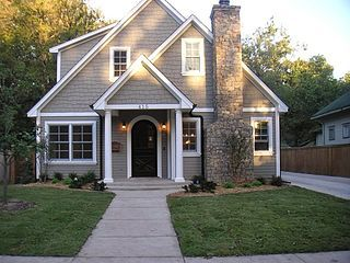 House body: Briarwood by Benjamin Moore Door paint color: Iron Ore by Sherwin-Williams Trim: Whisper White by