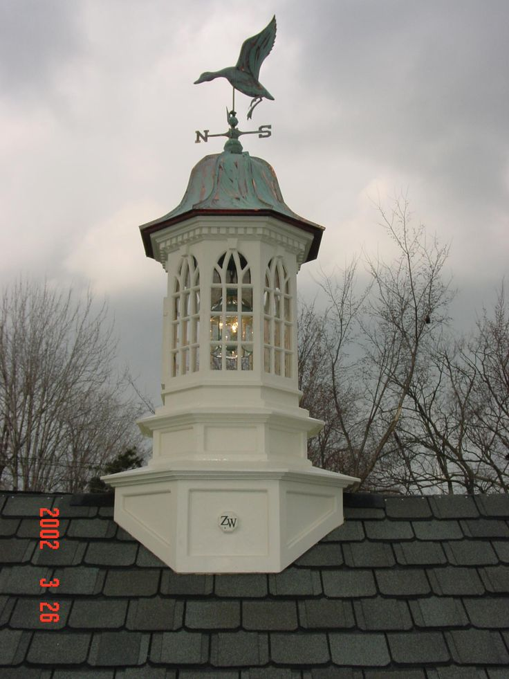 cupola and weathervane. Love the copper roof shape