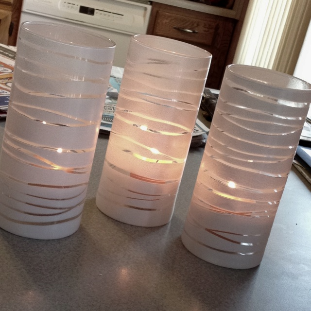 I made 6 of these! So easy just need dollar store vases, white spray paint, and rubber bands. My first two were too think these one are just one coat and still look awesome!