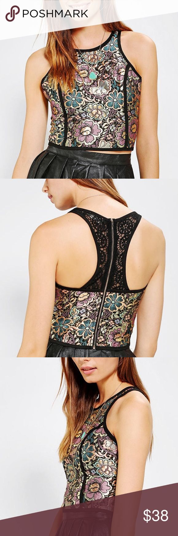 UO Cropped Jacquard Lane Back Tank Urban Outfitters Coincidence & Chance Metallic Cropped Jacquard Tank. Features metallic Floral print of gold, purple, pink, and blue flowers, lace racerback, and rear exposed zipper. First 3 photos are stock photos, 4th is of the actual garment tags. This item is NWT and shows no visible flaws. Size Large. Goes great with leather pants or skirt! Urban Outfitters Tops Crop Tops