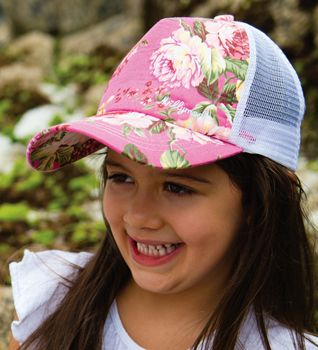 New season's girls trucker cap. Hot pink with hibiscus print on cotton, with a mesh back to keep the head cool. The snap back allow the size to be adjusted.