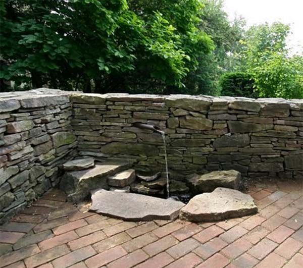 water feature built into stone wall 600×531