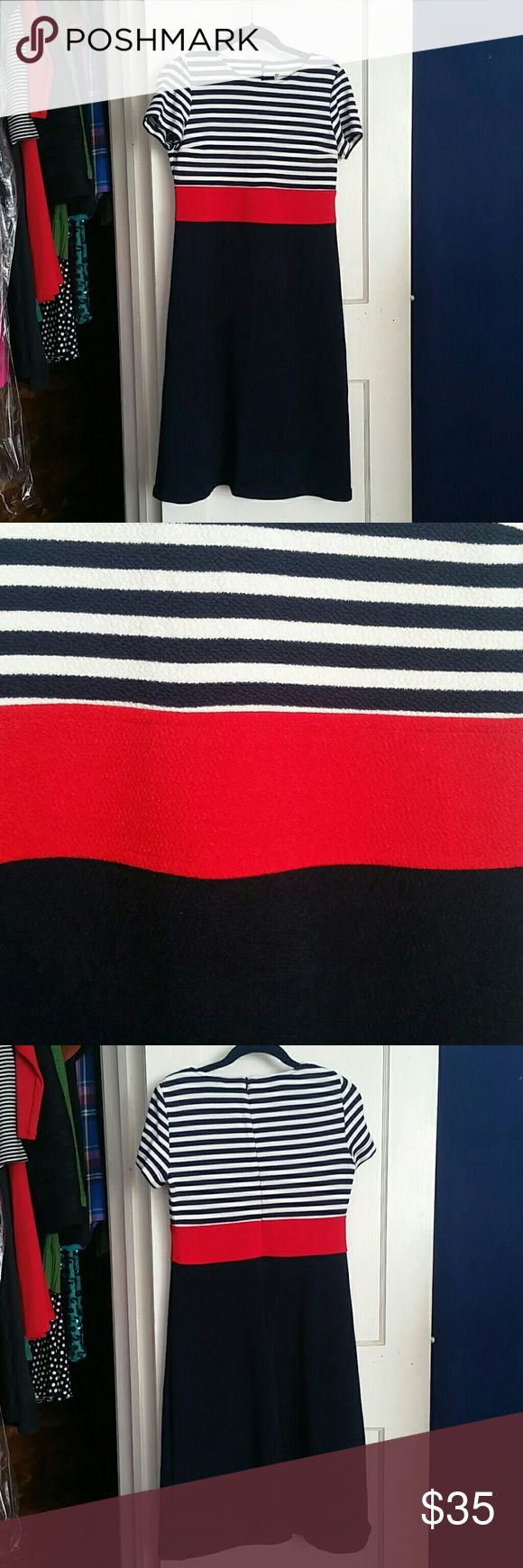 Coldwater Creek Nautical Stripe Dress Short sleeve A-line dress in red, white, and blue with nautical feel. Stripes to top bodice and slimming navy blue to bottom. Rayon/polyester/spandex blend. Overall length 40.75 inches. Bust 15 inches. Has some stretch. Coldwater Creek Dresses