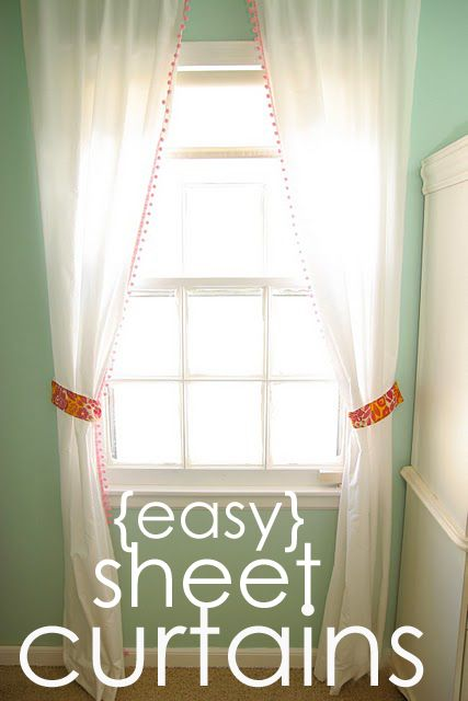 Curtains from sheets! (Might try a queen flat for a fuller curtain look or two twins instead of one split is a better idea...and the ball fringe for Little's big girl room? Adorable!!