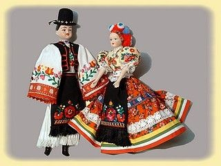 Hungarian dolls in traditional costume - pretty sure Nagypapa had (or has) some just like this!