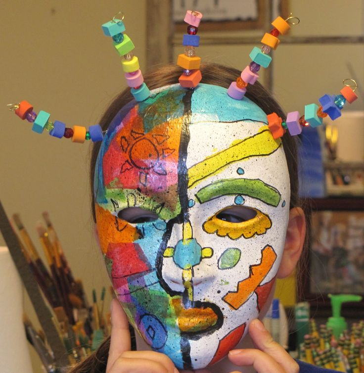 Picasso Masks-art project plaster bandage molding from the original plastic mask forms - build up, . I like the wire with beads sticking out for hair