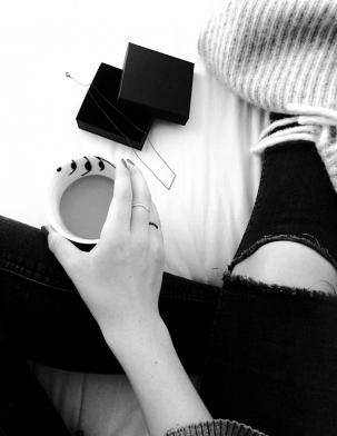Black and white picture. Coffee in bed and jewellery from Hvisk