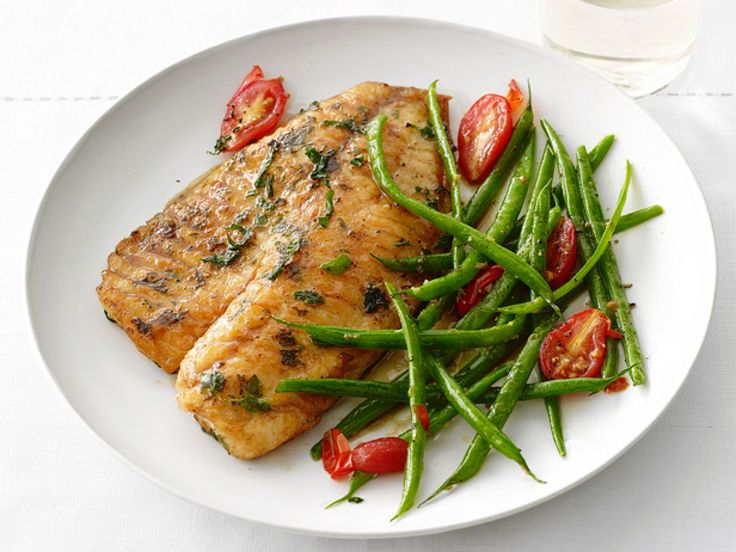 Tilapia and Green Beans : Tilapia is a versatile, inexpensive fish that's always popular with home cooks. Coat tilapia fillets in a flour-and-herb mixture, then fry them in butter until crispy. Serve the fish alongside lemony green beans and grape tomatoes.
