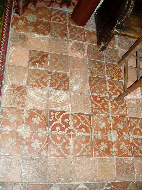 Medieval slipware tites.   Sanctuary floor at Wyre piddle, composed of fine 15th century encaustic tiles forming rosette patterns. The small church at Wyre Piddle on the northern edge of Pershore had no dedication until 1989, when it was dedicated to St Anne.