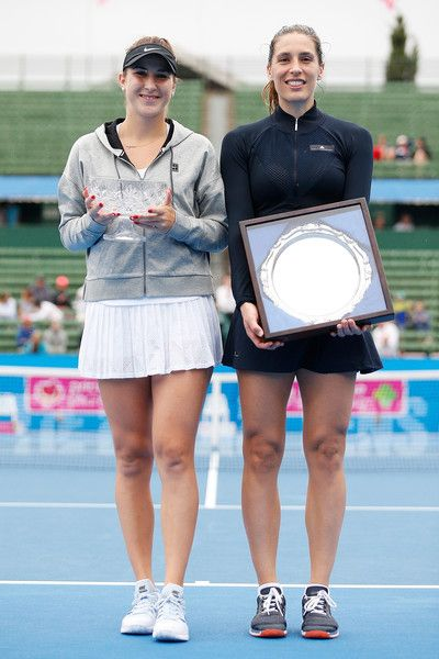 Belinda Bencic Photos - Belinda Bencic of Switzerland (L) and Andrea Petkovic of Germany (R) pose for a photo after defeating Andrea Petkovic of Germany in the Women's Singles Final during day four of the 2018 Kooyong Classic at Kooyong on January 12, 2018 in Melbourne, Australia. - 2018 Kooyong Classic - Day 4