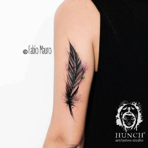Feather tattoo on the left tricep. Tattoo artist: Fabio Mauro