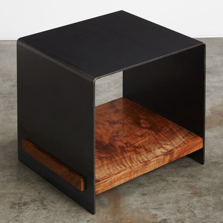A blackened steel bi-fold table with a solid wood slab shelf. Available in several wood species; those shown are walnut, English elm, and madrone. Please call one of our showrooms for availability.