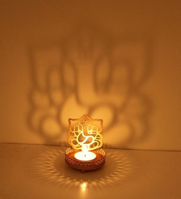 Decorate your favourite corner or the pooja room with a simple or a perfumed candle with this set of Golden Crowned Ganesha Candle Holder -www.cooliyo.com