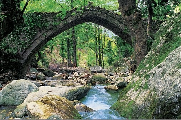 Arched stone bridge over a natural water stream in Mylopotamos #Pelion#Volos#Greece