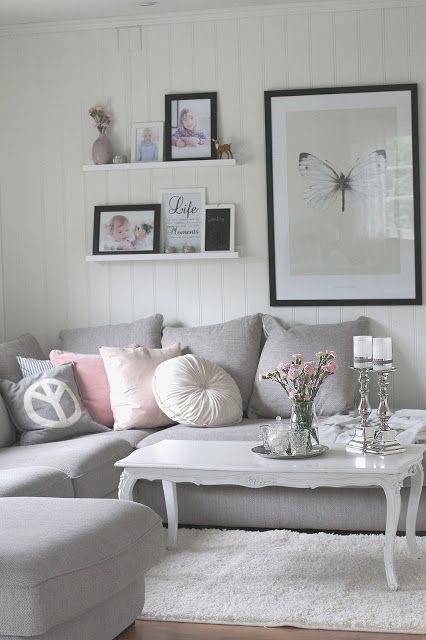 Grey sofa and pastel accents. http://www.lykkeimitthjerterom.com/2013/08/nib-utfordring-stuepike.html