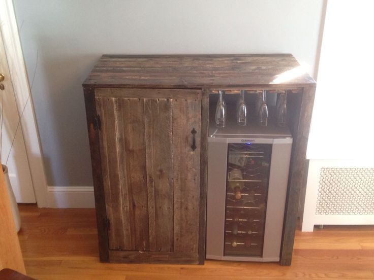 My first pallet project. Rustic Liquor cabinet with built in wine fridge.  Viola!