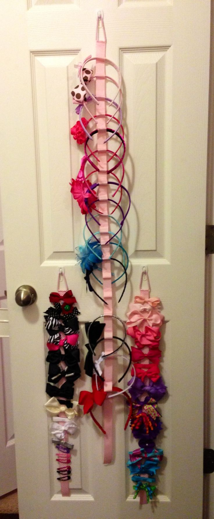 Hair accessory organization made from ribbon, ponytail holders and hot glue. Easy, inexpensive and controls clutter.