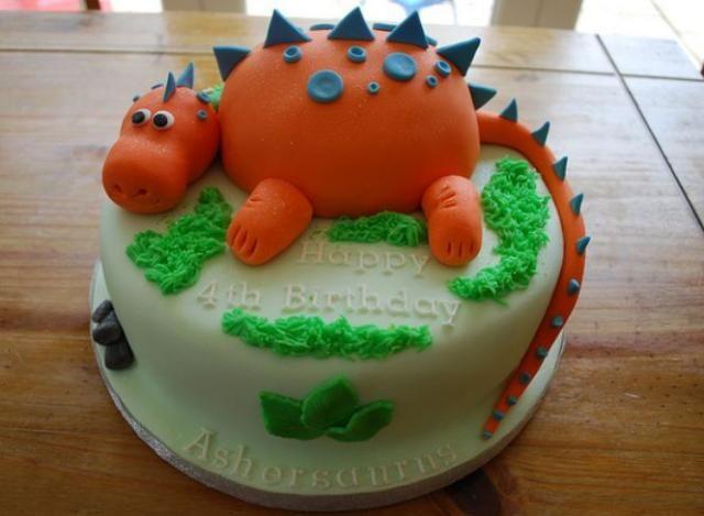 Orange dinosaur round birthday cake