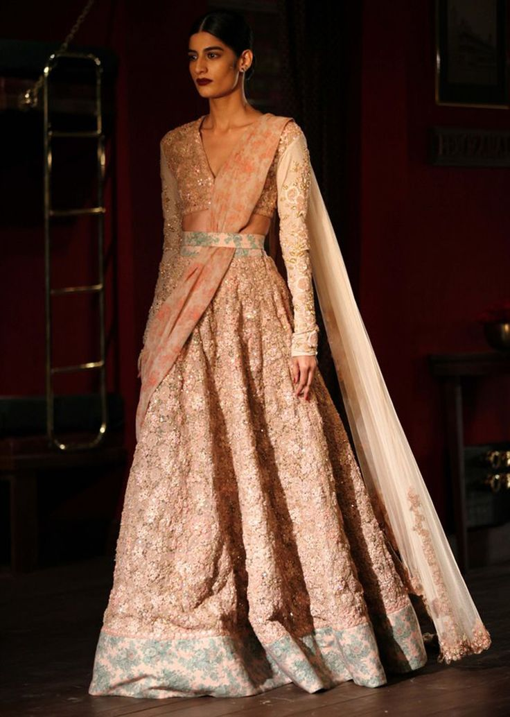 Model wearing shaded cream top with peach anarkali for sabyasachi at Indian couture week July 2014
