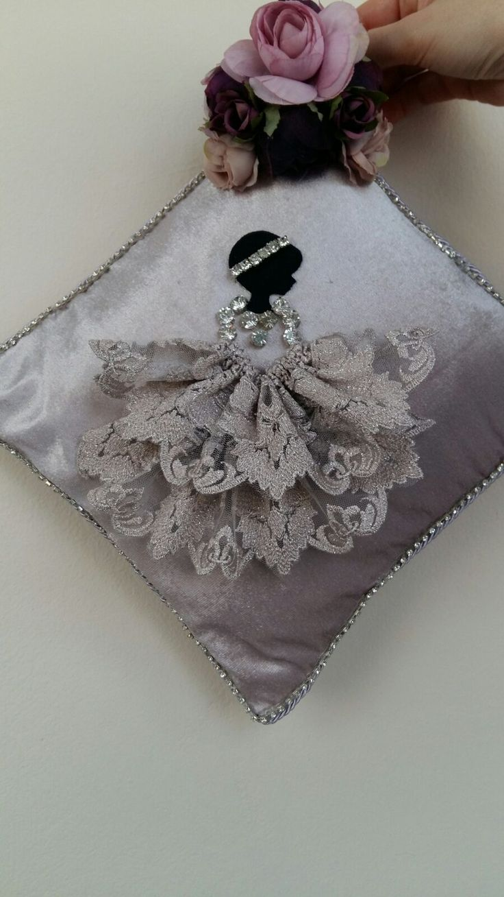 Decorative pillow with doll and lace