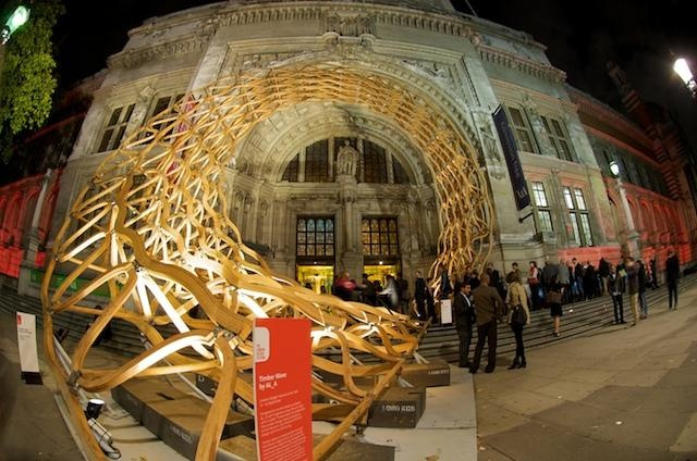 Award-winning architects AL_A and engineering firm Arup transformed the V Museum's Grand Entrance on Cromwell Road with the installation of a giant timber wave cascading down the steps. Built from oil-treated American red oak, Timber Wave was a three-dimensional latticework spiral, 12 metres in diameter, that employs construction techniques and materials normally used in furniture making to create a majestic three - storey - high structure.