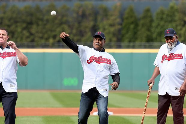 Cavs legend Austin Carr throws the first pitch across the plate, accompanied by Jim Thome, left, and Jim Brown. The trio had the honor of throwing out the 2017 opening day pitch on Tuesday, April 11 2017. The Cleveland Indians took on the Chicago White Sox.  (Chuck Crow/The Plain Dealer)