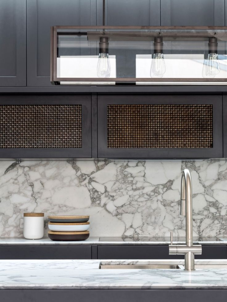 Balancing Home by Luigi Rosselli Architects | Statuario marble benchtop and aged woven brass mesh | © Justin Alexander nice marble