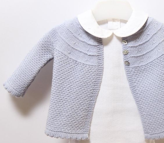 Lovely lilac baby cardigan to keep your little one cosy! Find the pattern on LoveKnitting.com