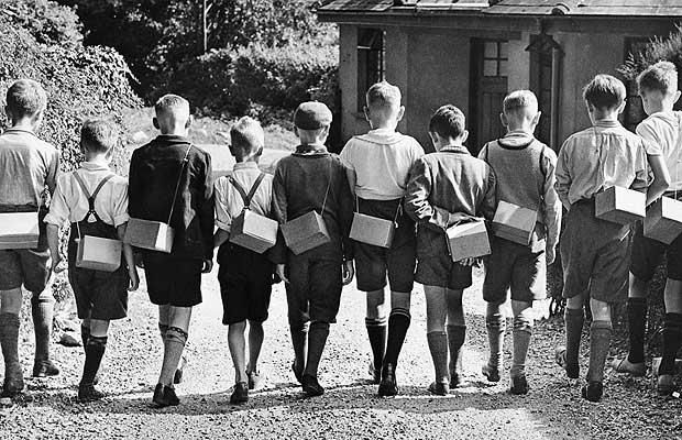 Boy evacuees with gas masks; Second World War: evacuating London