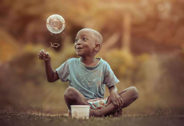Childhood fun in Jamaica - Adrian McDonald/REX